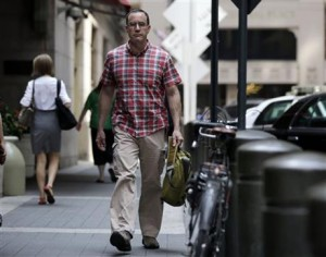 Photo from Associated Press. In this July 22, 2014 photo, AIDS activist Gregg Gonsalves walks outside Grand Central Terminal during a photo session, in New York. In the early 1990s, Gonsalves traveled to Washington to confront, provoke and challenge officials at the Food and Drug Administration. A quarter century later, he still travels to Washington, but with a very different agenda: to defend the FDA. (AP Photo/Richard Drew)